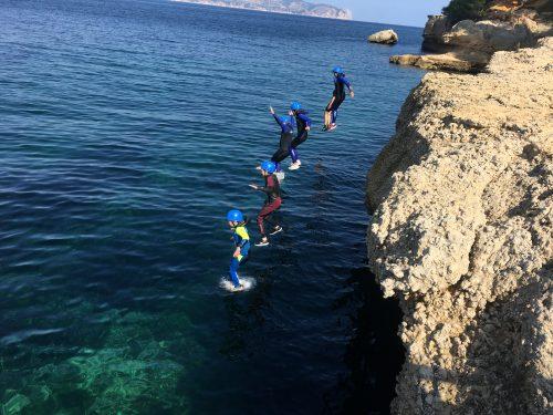 Coasteering group jumping
