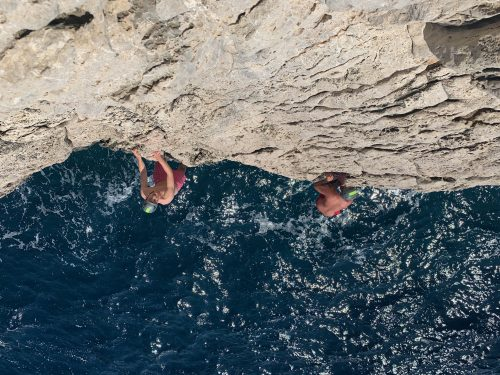 Deep water soloing with outdoor adventure sports
